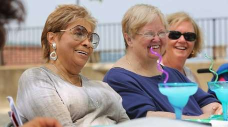 From left, Valerie Watkins of Westbury, Joan Ortiz