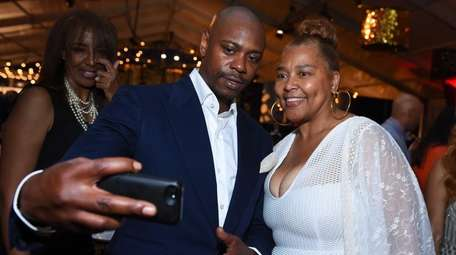 Dave Chappelle and a fan take a selfie