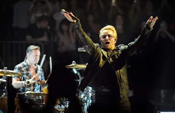 Bono performs with U2 live at Madison Square