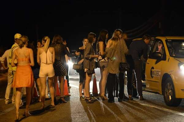 Montauk revelers wait quietly for taxis early Sunday,