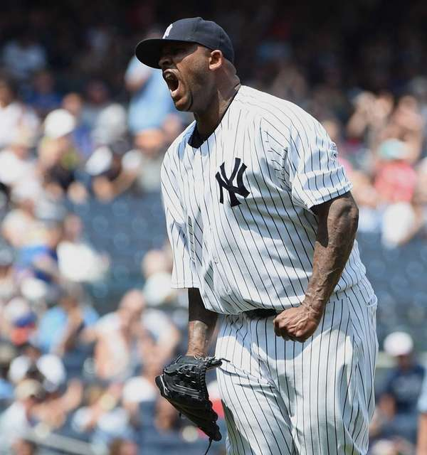 New York Yankees starting pitcher CC Sabathia reacts