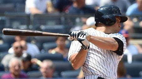 Yankees rightfielder Carlos Beltran follows through on his