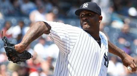 Yankees starting pitcher CC Sabathia delivers a pitch