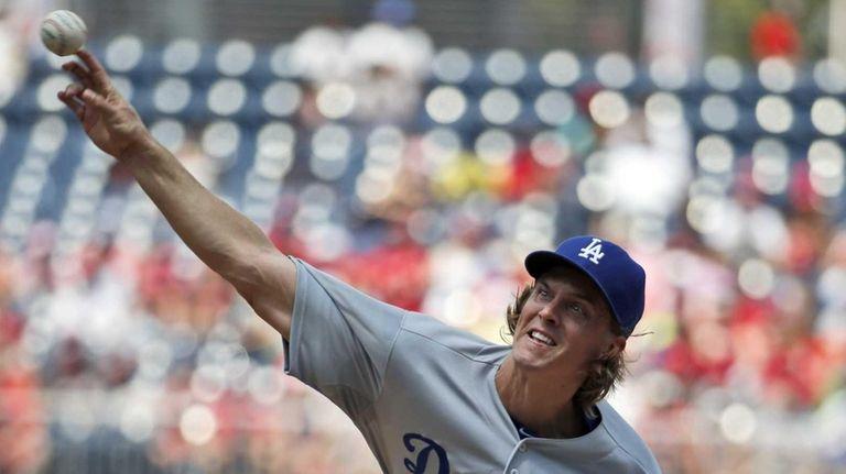 Los Angeles Dodgers starting pitcher Zack Greinke throws