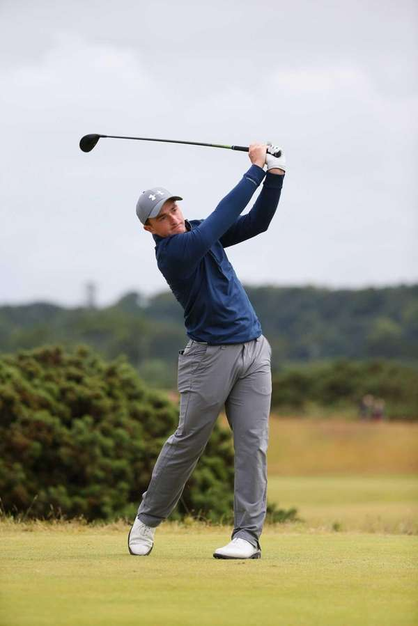 Amateur Paul Dunne of Ireland tees off on