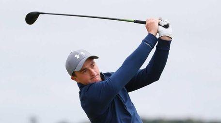 Amateur Paul Dunne of Ireland tees off on