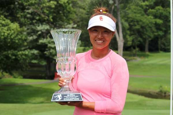 Annie Park of Levittown holds the trophy she