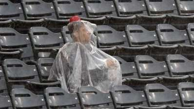 A lone fan sits in the rain during