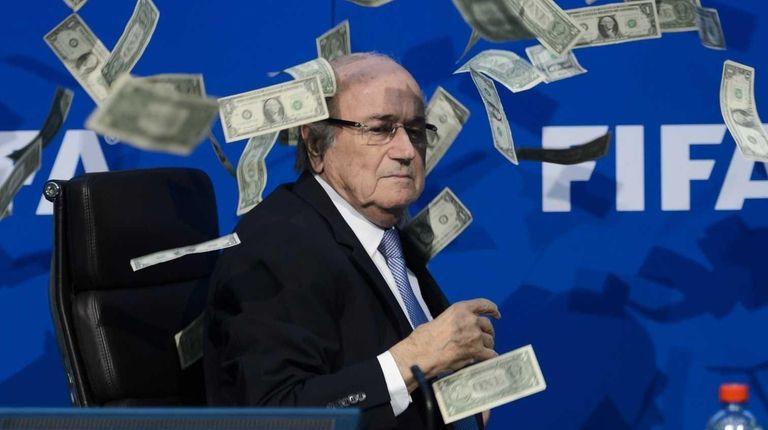 FIFA president Sepp Blatter looks on with fake
