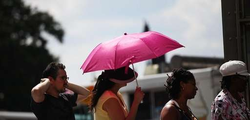 A woman holds an umbrella on a Manhattan