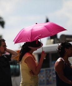A woman holds an umbrella on a Manhattan