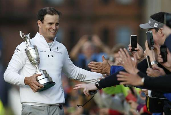 Zach Johnson celebrates with members of the public