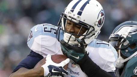 The Tennessee Titans' Justin Hunter, left, is tackled
