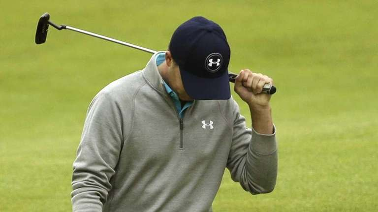 Jordan Spieth reacts after missing a putt on