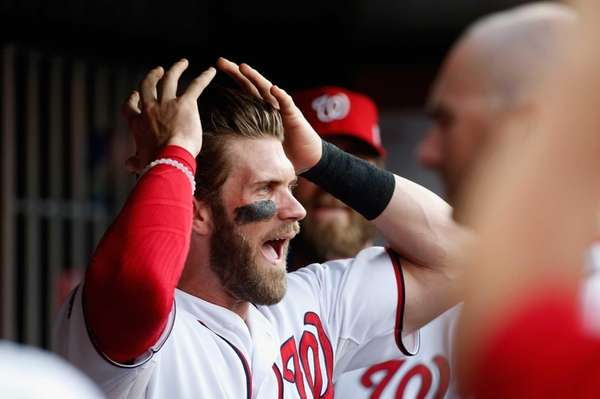 Bryce Harper of the Washington Nationals looks on