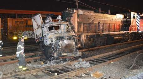 A truck and train collided early July 8,