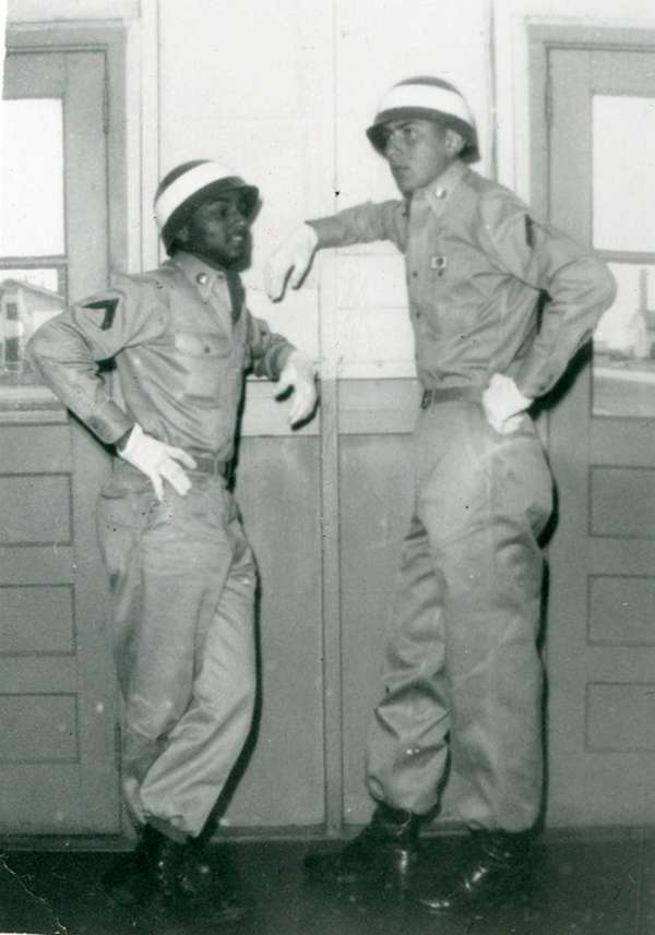 Pvt. 1st Class Robert Ricken, right, with his