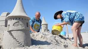Professional sand sculptors Andy Gertler and Sue Beatrice,