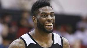 The Brooklyn Nets' Willie Reed laughs during a