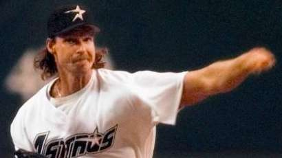 Houston Astros pitcher Randy Johnson delivers the first