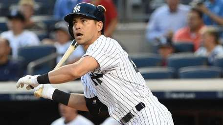 New York Yankees centerfielder Jacoby Ellsbury doubles against