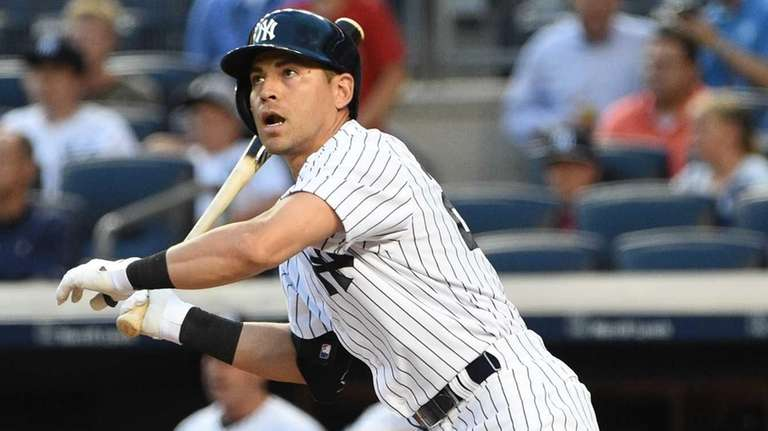 New York Yankees centerfielder Jacoby Ellsbury doubles against