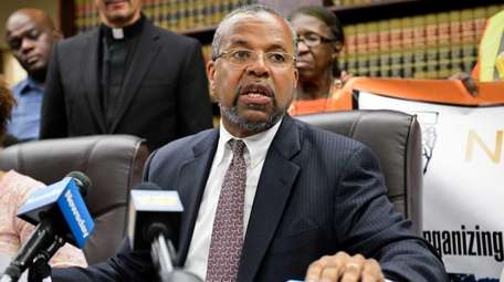 Attorney Fred Brewington speaks at a press conference
