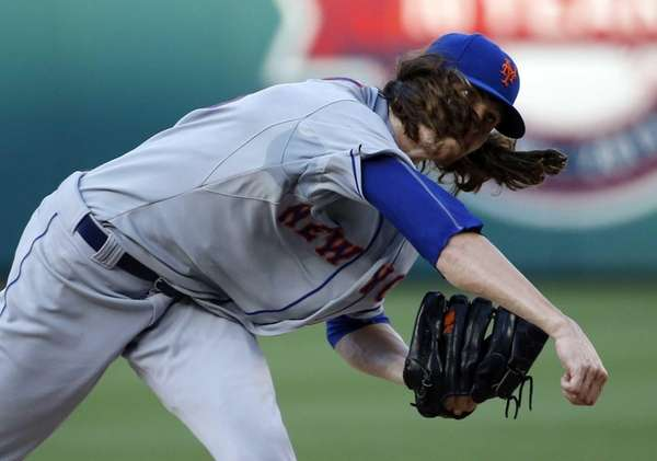 New York Mets starter Jacob deGrom follows through