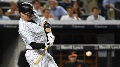 Yankees second baseman Brendan Ryan hits an RBI