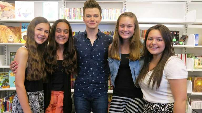 Actor and author Chris Colfer with Kidsday reporters