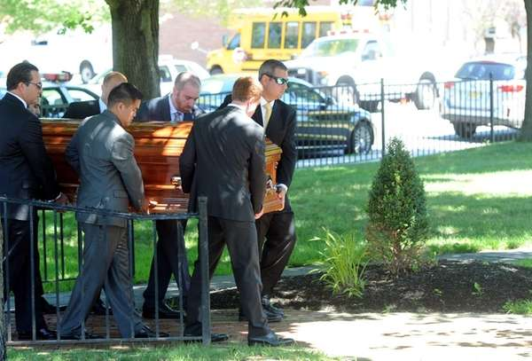 The coffin of Lauren Baruch is carried into