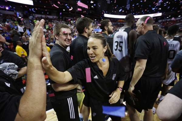 San Antonio Spurs coach Becky Hammon celebrates with