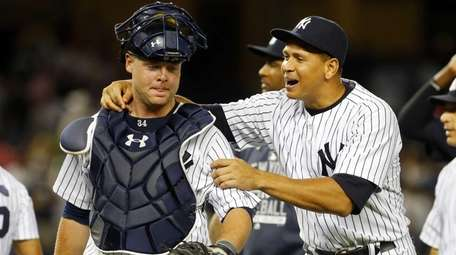Brian McCann and Alex Rodriguez of the New