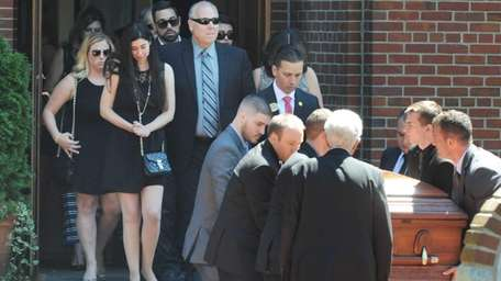 Family members follow behind the casket of Brittney