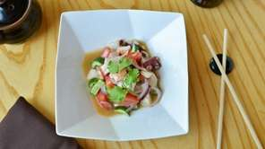Mixed seafood ceviche cured in lime citrus at