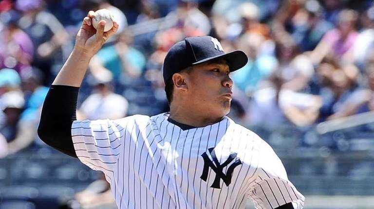 Masahiro Tanaka pitching during the first inning against