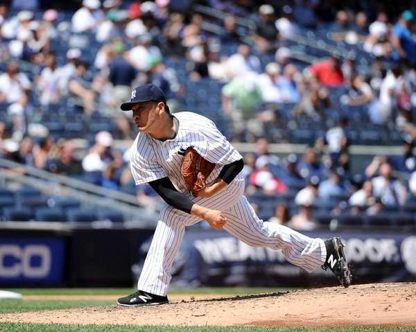 Masahiro Tanaka of the Yankees pitches during a