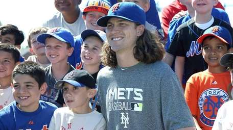 Camp attendees gather together during visit by Mets