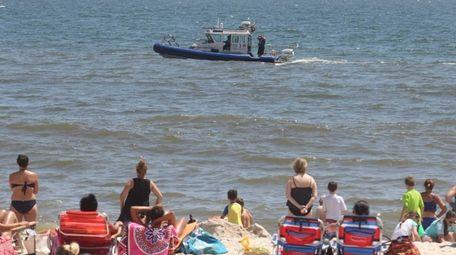 A Bay Constable boat patrols waters off Tobay