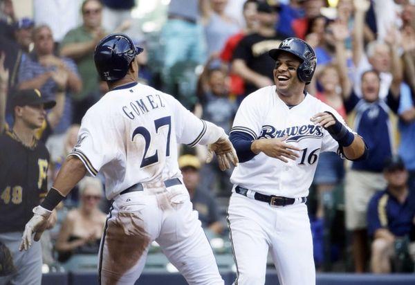 Milwaukee Brewers' Carlos Gomez and Aramis Ramirez celebrate