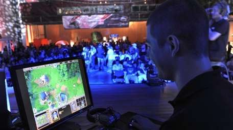 A participant plays a computer game during the
