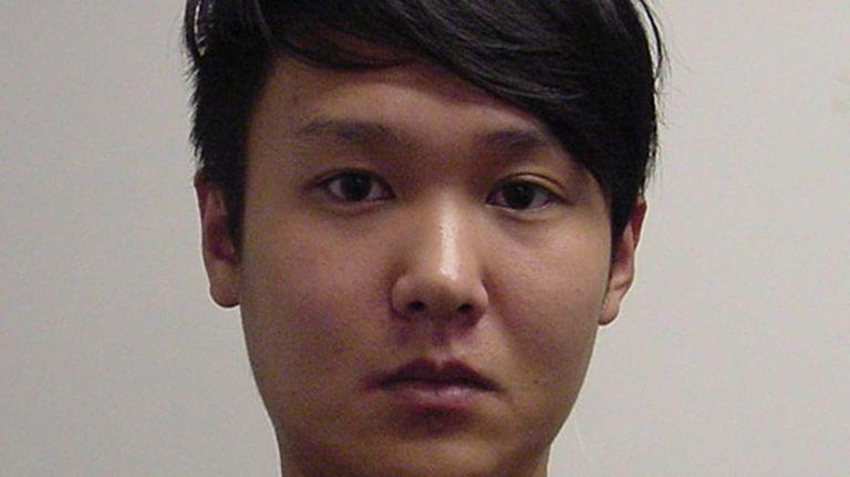 Bing Jie Yang, 23, of Westbury, is accused
