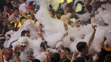 Spring break revelers participate in a foam party