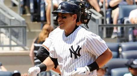 Jacoby Ellsbury of the Yankees roundd third base