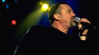 Billy Joel performs at Nassau Coliseum in 1998