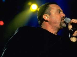 Billy Joel performs at Nassau Coliseum in 1998