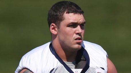 Denver Broncos defensive end Derek Wolfe works out