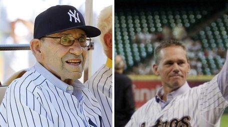 Yogi Berra (left) is seen at the Yankees'