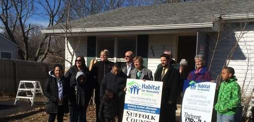 Officials with Habitat for Humanity's Suffolk chapter gather