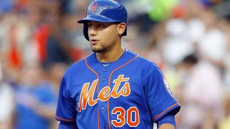 Michael Conforto of the Mets walks to the